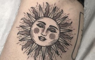 Black and Grey Sun Tattoo by Fiona