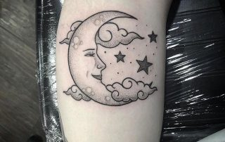 IG post of Black and Grey Moon Tattoo by Fiona