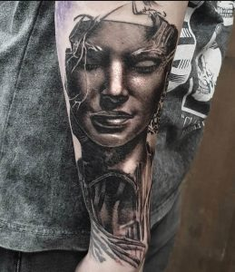 Black and Gray Statue Tattoo by Clayton