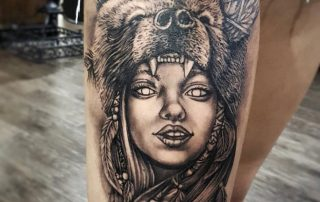 Native American Girl with Bear Head Tattoo by Clayton