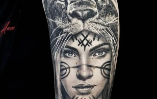 Native American Girl with Lion Head Tattoo by Clayton