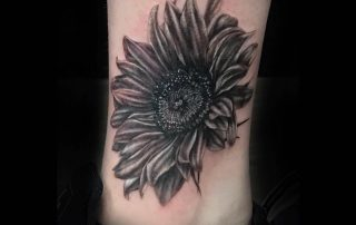 Black and Grey Realism Sunflower Tattoo by Liberty