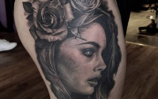 Woman with Floral Hair Tattoo by Sebastian