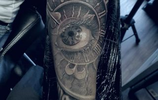 Clock Face with Realism Eye Tattoo by Sebastian