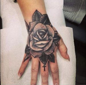 Hand rose tattoo by Dan from Walsall